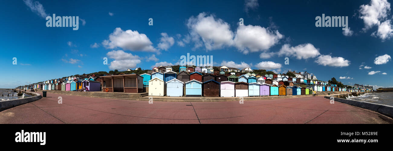 Colourful beach hut panorama at Clacton-on-Sea is the largest town in the Tendring peninsula and district in Essex, - Stock Image