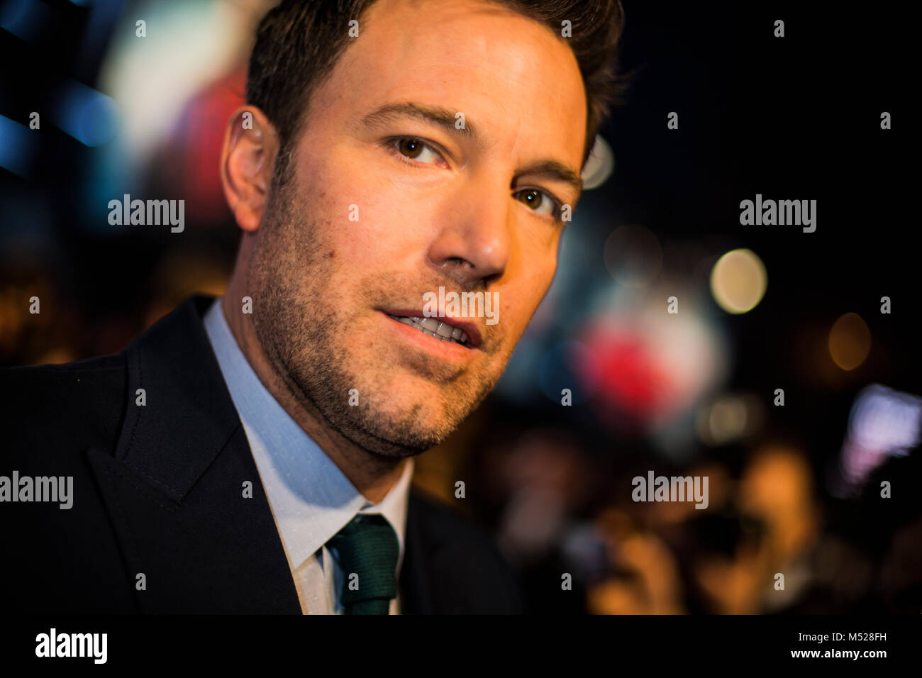 Ben Affleck who stars as Bruce Wayne/ Batman in the film as he walks down the red carpet at the Superman Vs. Batman - Stock Image