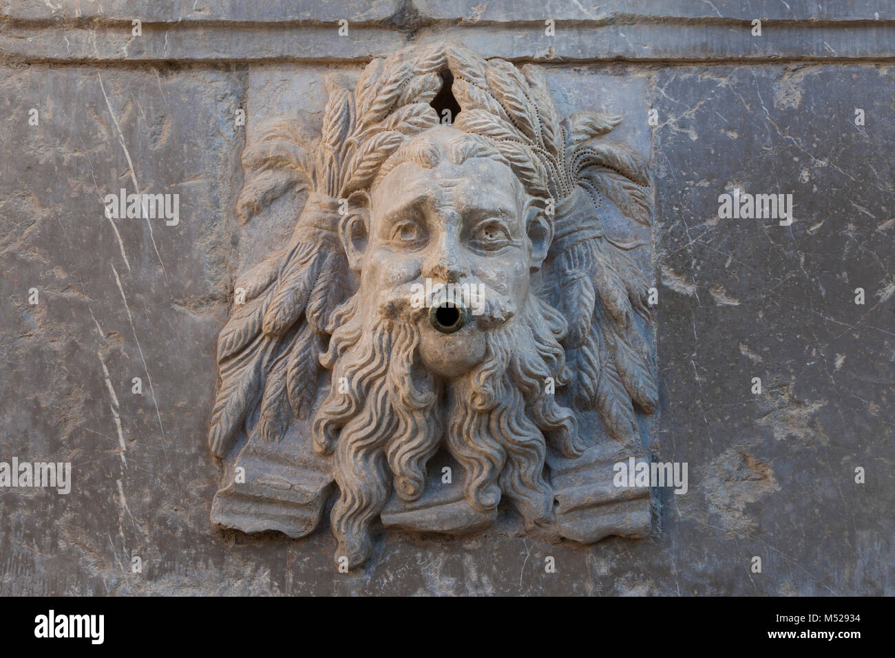 Granada, Spain: Figurehead on the fountain of Charles V's Pillar at the Alhambra Palace and Fortress. The three - Stock Image