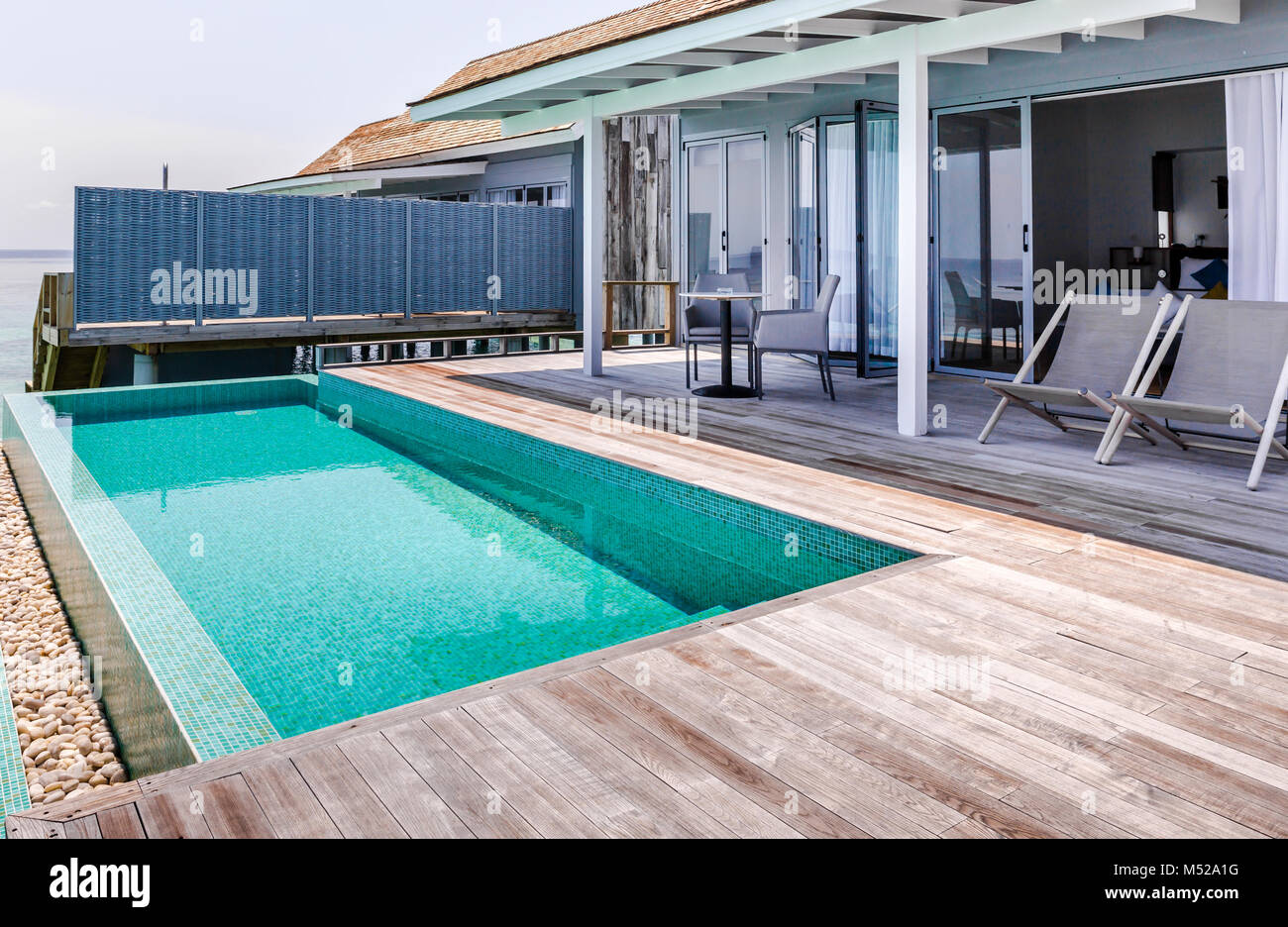 Private Swimming Pool And Terrace Of Water Villa In Maldives Stock Photo Alamy
