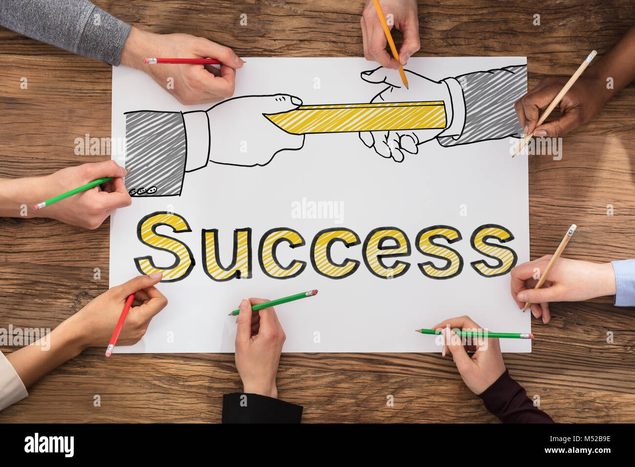 Hands Drawing Business Success Concept On Paper - Stock Image