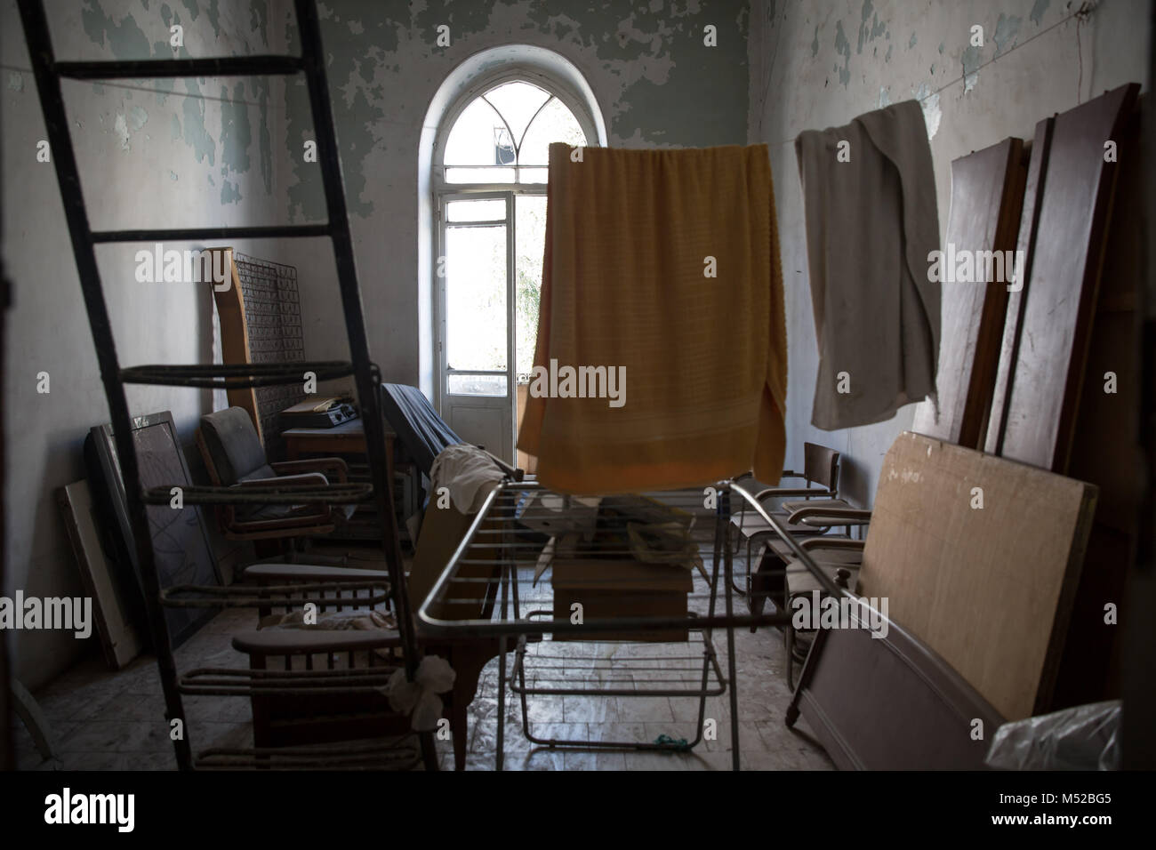Washing hung out in a room upstairs in the Baron Hotel, which sheltered families during the fighting in Aleppo. - Stock Image