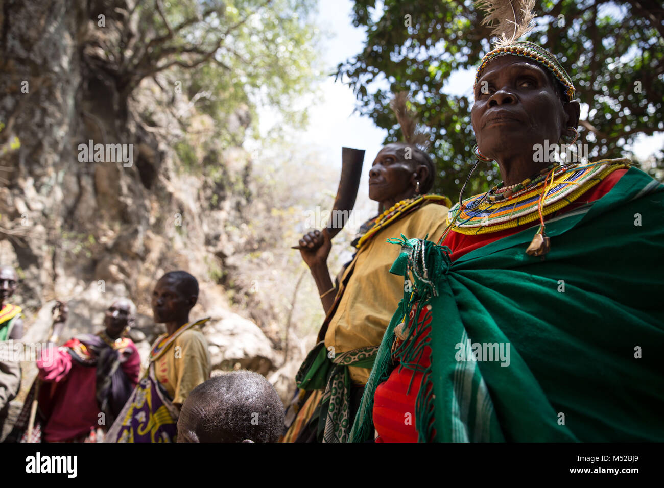 """Former """"cutters"""" from the Pokot tribe stand together. They used to make 1,000 Kenyan shillings for each girl they Stock Photo"""