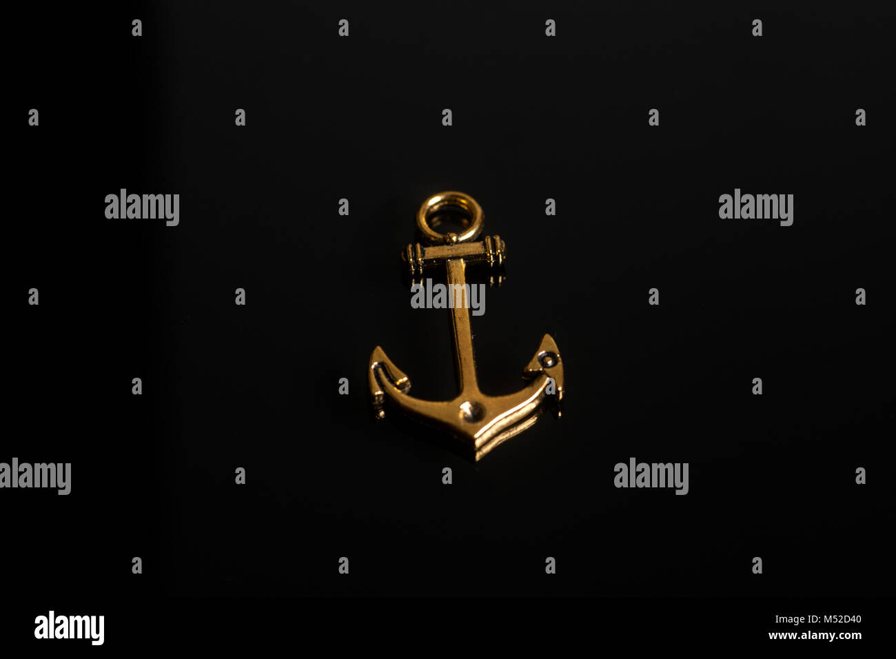 Gold Anchor Jewel On A Black Background