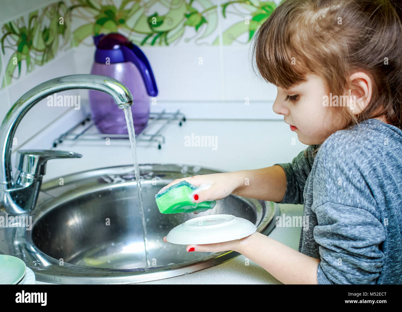 Baby Girl Dishes In Kitchen Stock Photos & Baby Girl Dishes In ...