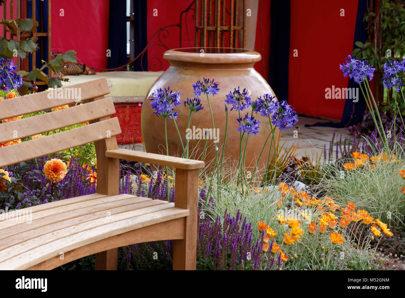 Garden Bench And Terracota Pot And Agapanthus Stock Photo