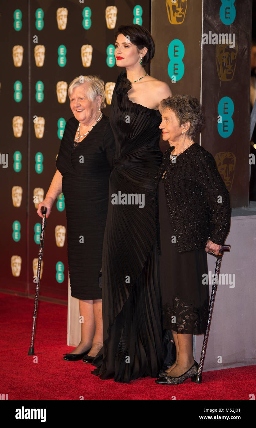 Gemma Arterton with Eileen Pullen and Gwen Davis attends the EE British Academy Film Awards (BAFTA) held at Royal - Stock Image