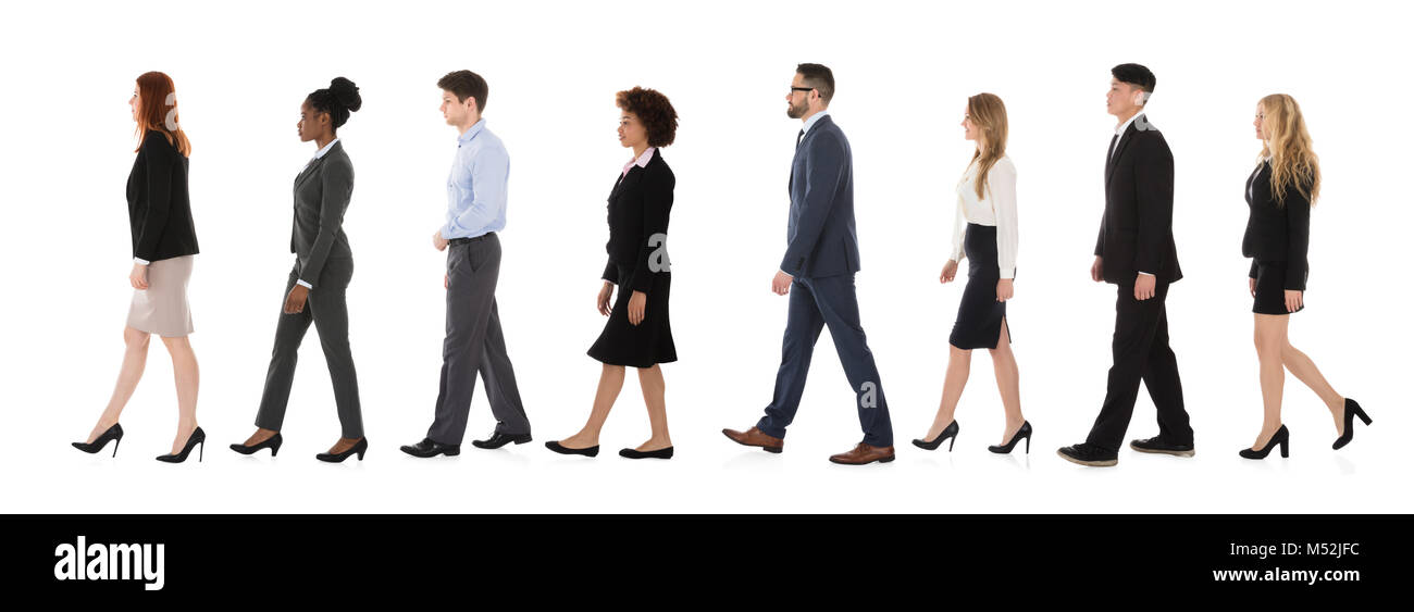 Businesspeople Walking In A Line Over White Background - Stock Image
