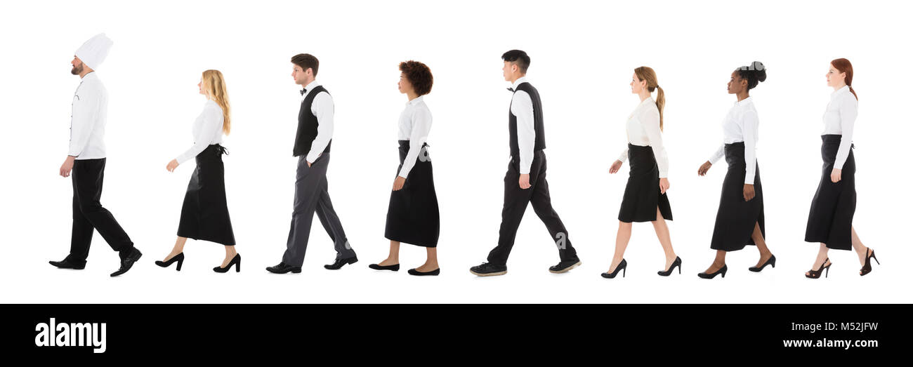 Group Of Restaurant Workers In A Line Over White Background - Stock Image