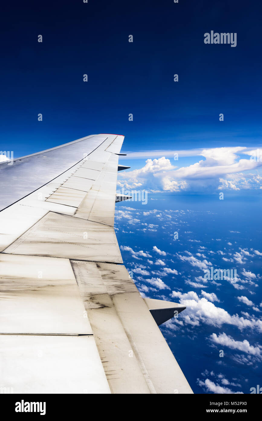 view of the wing of an airplane through the window Stock Photo