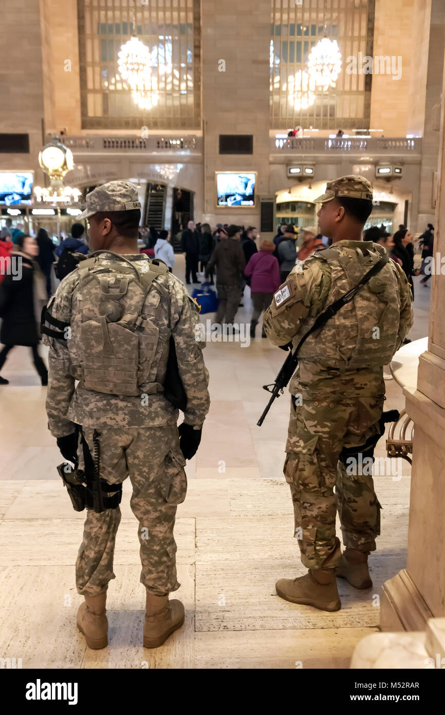 Army National Guard officers keeping watch in Grand Central Station, New York, NY., USA - Stock Image