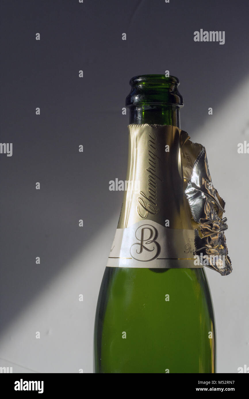 An opened bottle of Champagne, signifying 'the morning after' - Stock Image