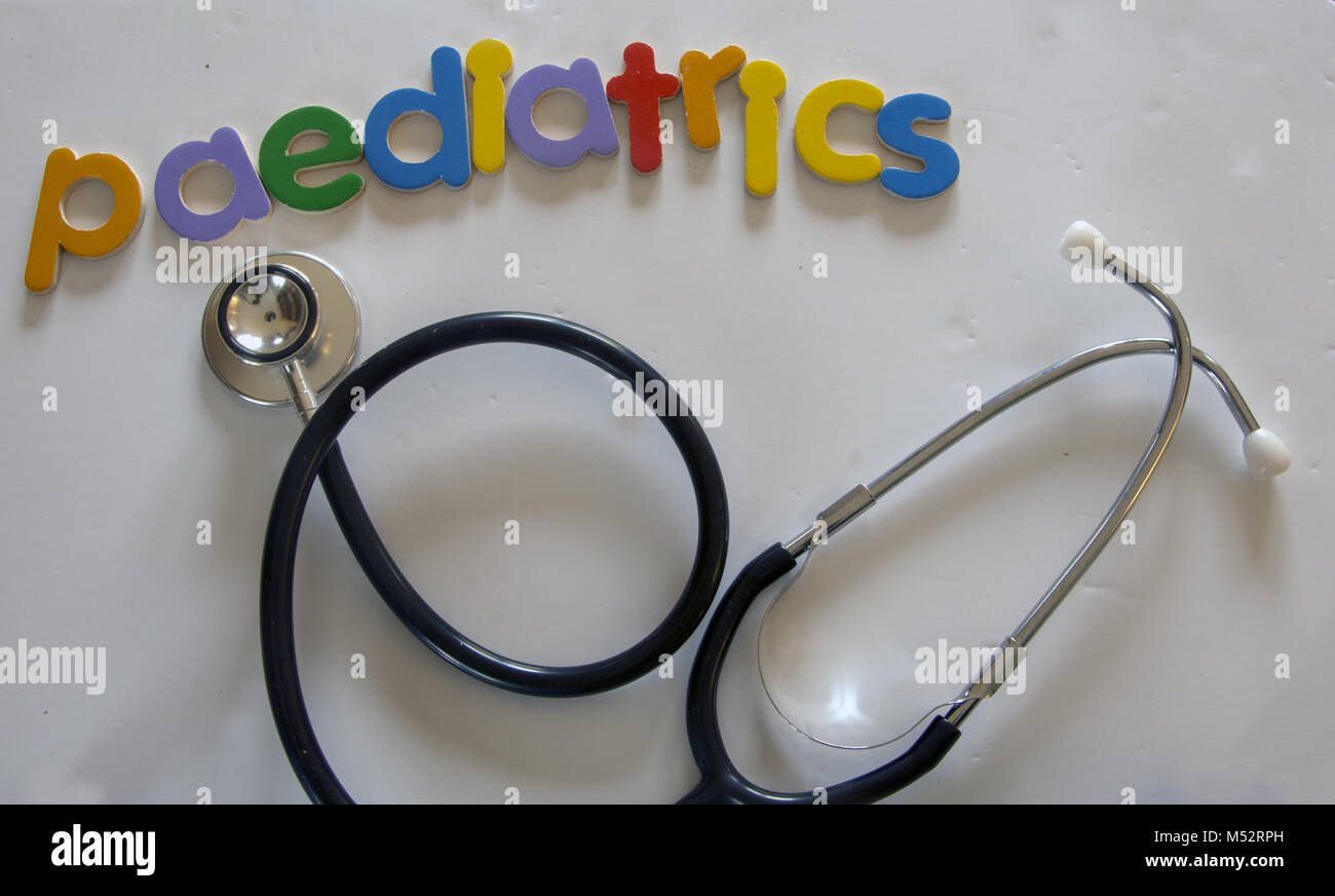 Paediatric medicine concept image - coloured wooden letters spelling out paediatrics, and a stethoscope - Stock Image