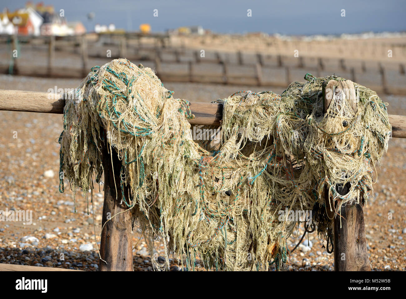 Discarded trawler net washed up on Pevensey Bay beach, East Sussex, UK - Stock Image