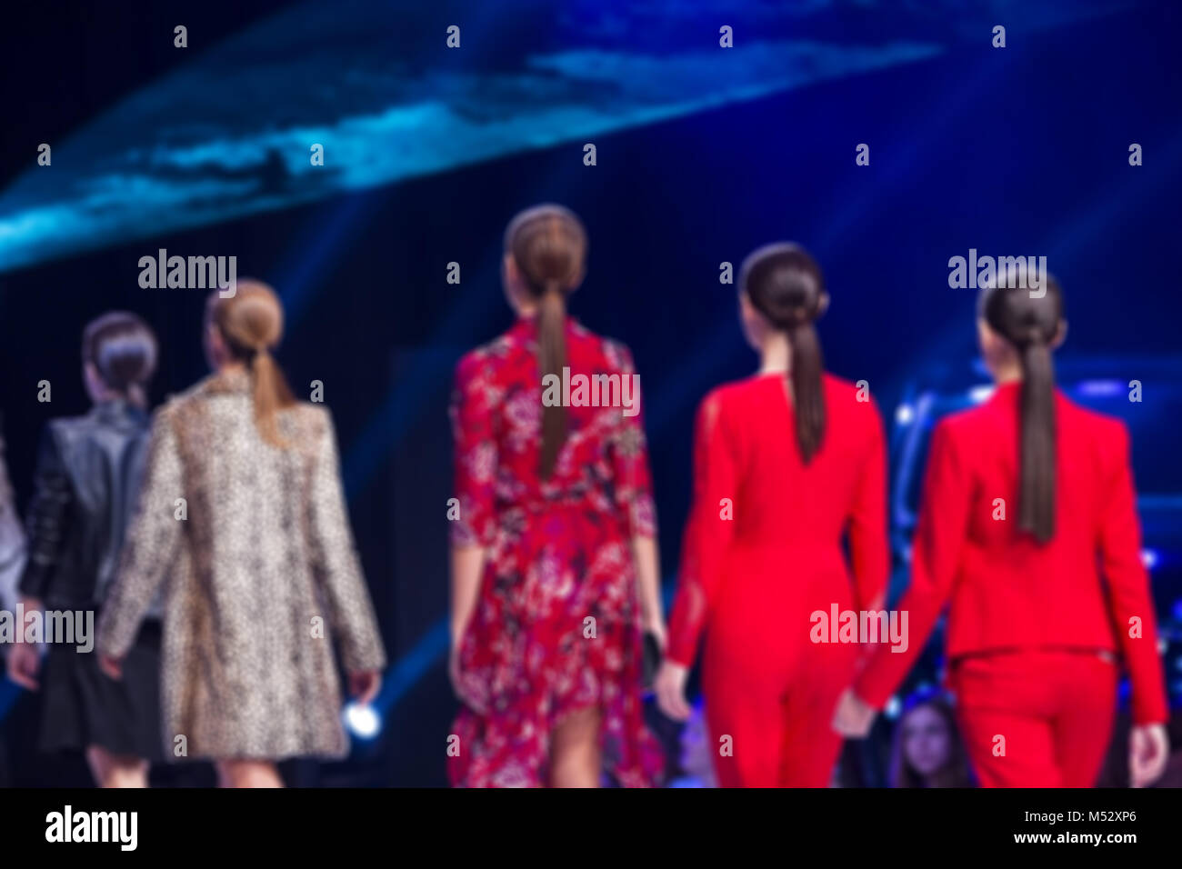Sofia Fashion Week female models backs red suits - Stock Image