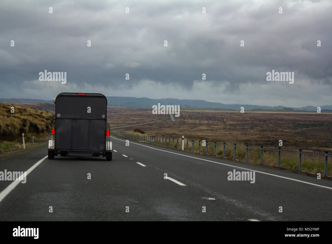 Driving through Beautiful Desert road - Stock Image