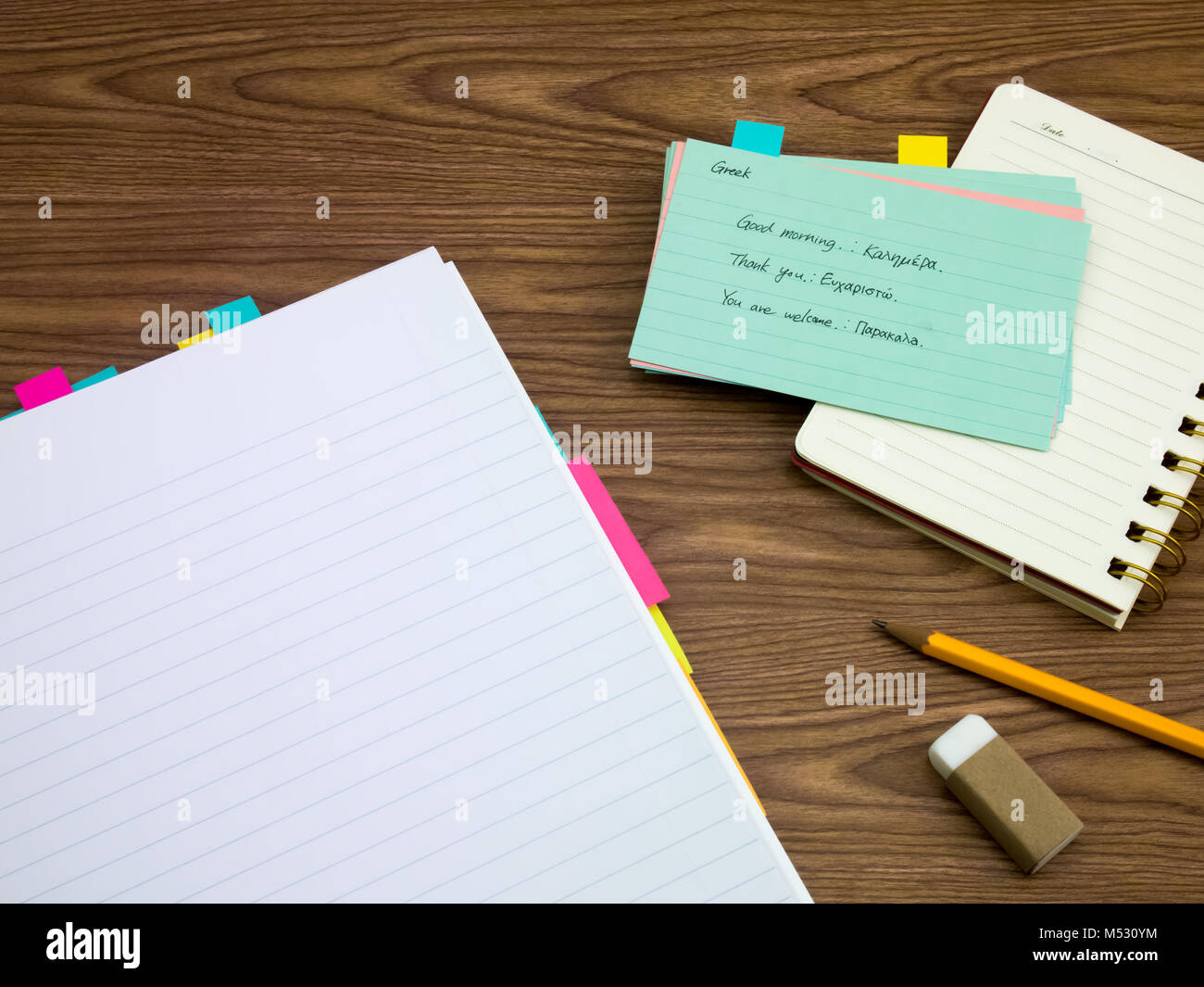 Greek; Learning New Language Writing Words on the Notebook - Stock Image