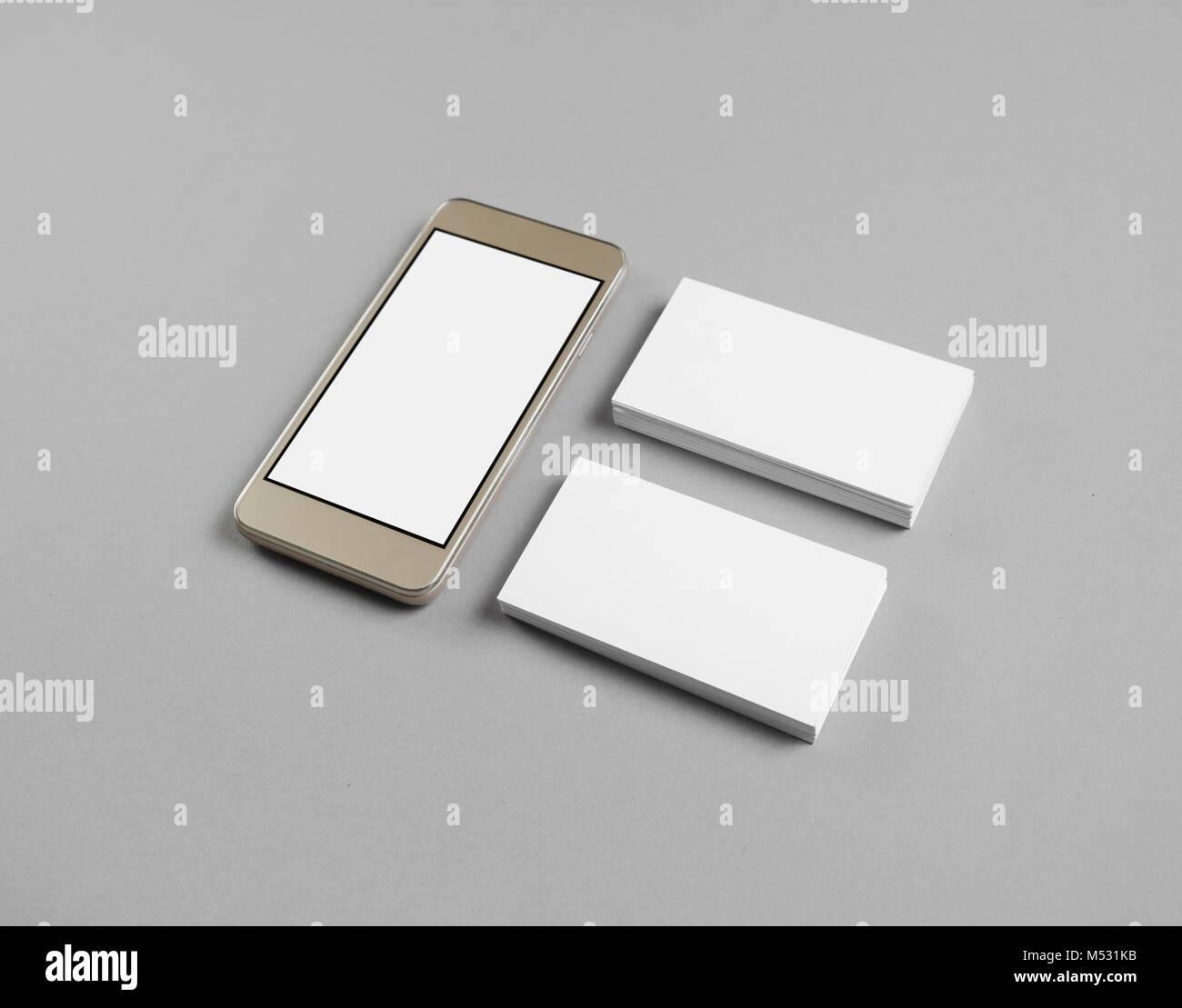 Smartphone, business cards Stock Photo: 175244143 - Alamy