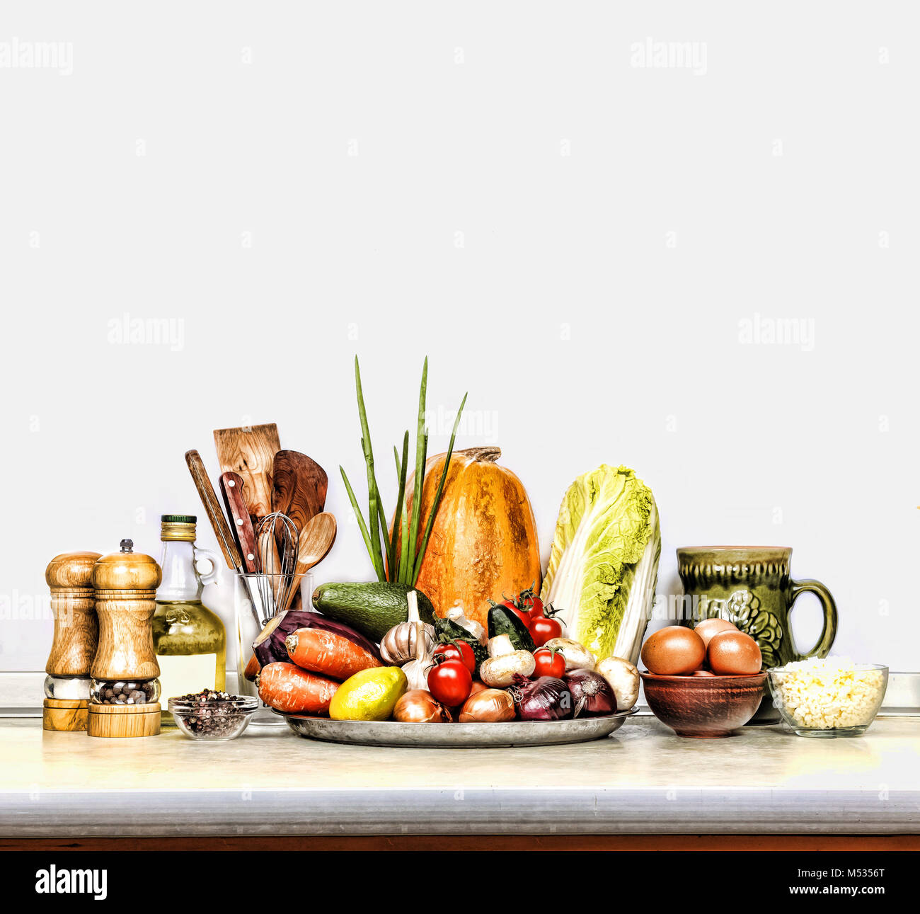 different foods on the kitchen table. White background. isolate ...
