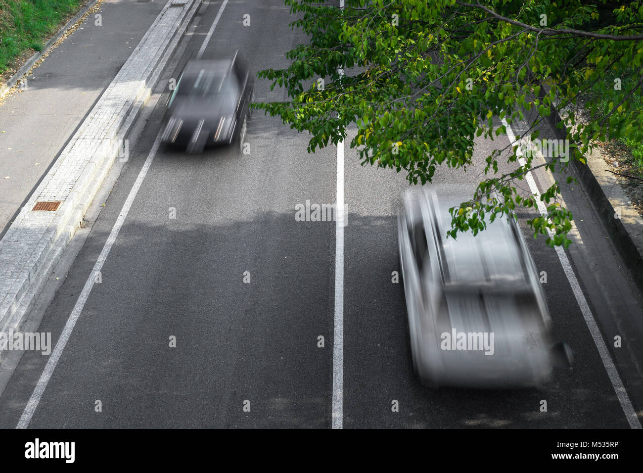 Motion blur of cars over the road - Stock Image