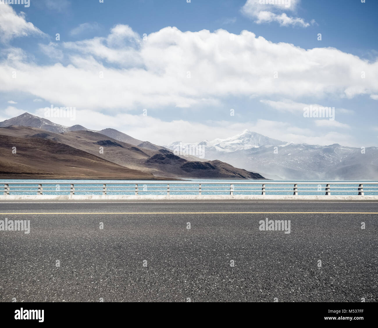road with holy lake in tibet - Stock Image