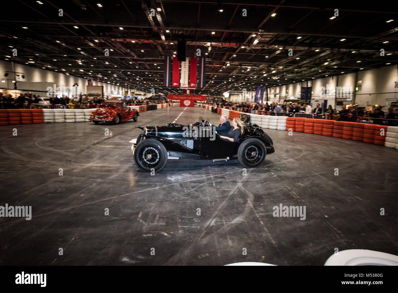 1934 Lancia Astura driving demonstration at The London Classic Car Show & Historic Motorsport International - Stock Image