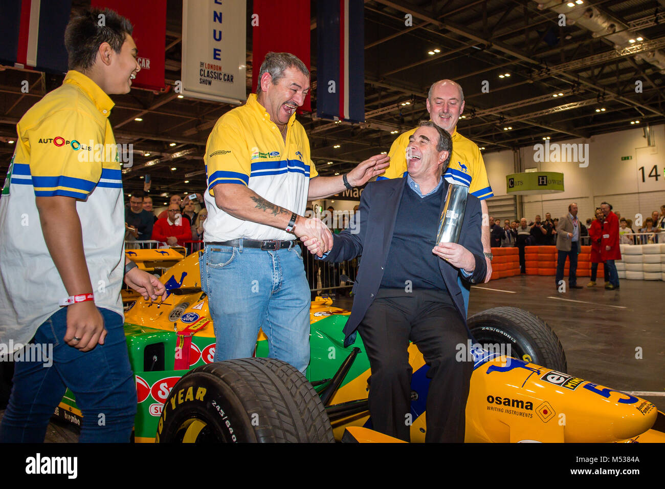 Nigel Mansell with the Benetton 193B F1 team at The London Classic Car Show & Historic Motorsport International - Stock Image