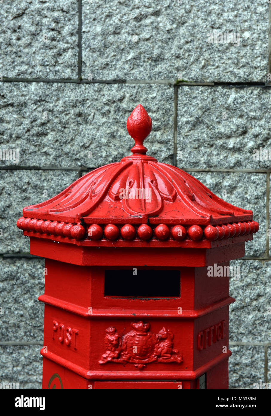 An old fashioned vintage or antique posting box or post mailing box for the collection and postal service of letters - Stock Image