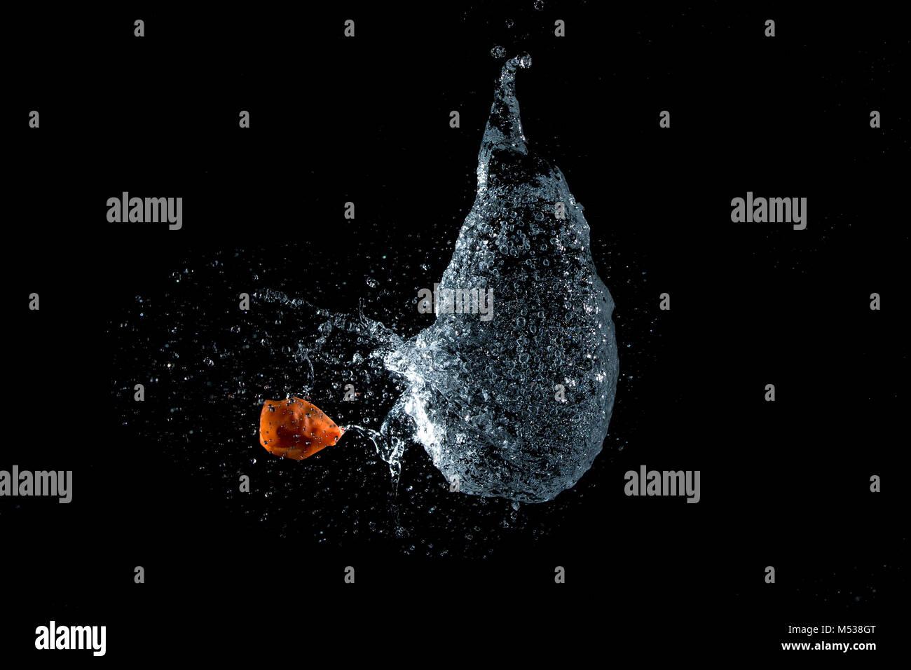 Water Balloon teardrop bursting - Stock Image