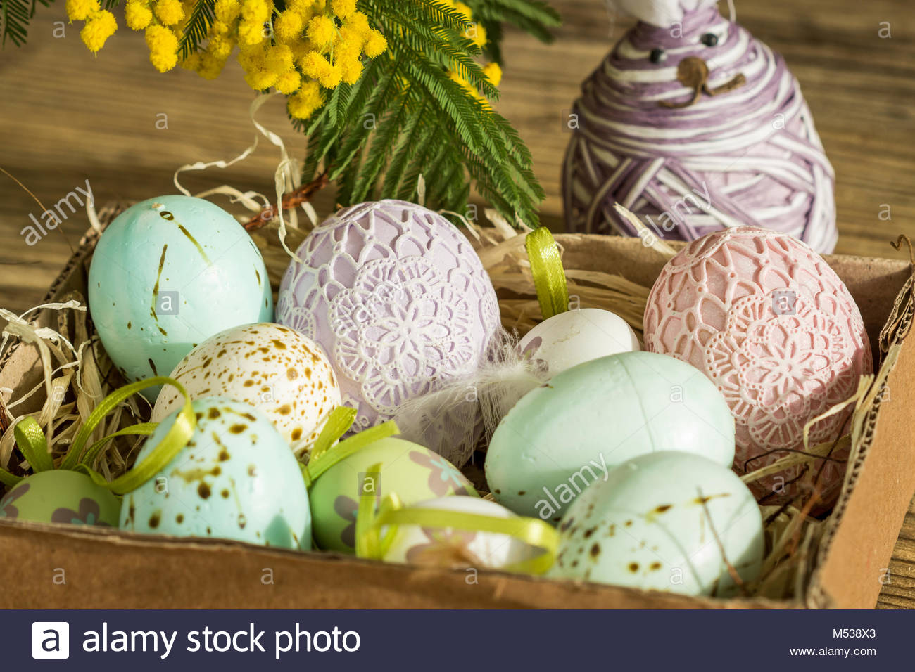 Hand Decorated Easter Eggs And Speckled Birds In Straw With A Branch Of Colorful Yellow Clusters Mimosa Flowers Natural Country Ba