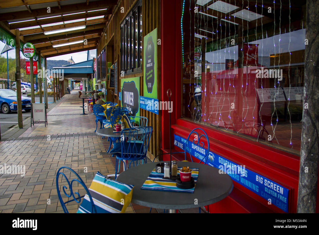 coffee terrace with christmas lights in the window new zealand stock image