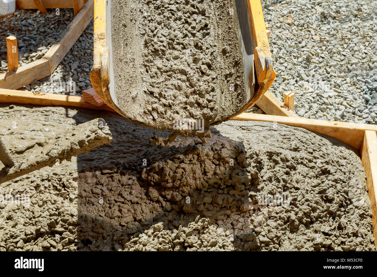 Concreting sidewalk around the house Stock Photo
