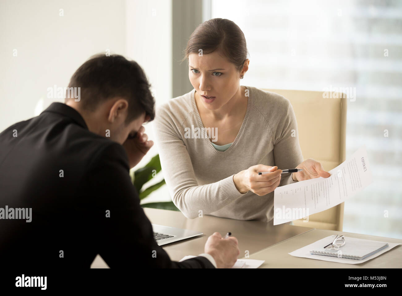 Business lady insists on changing of contact text - Stock Image