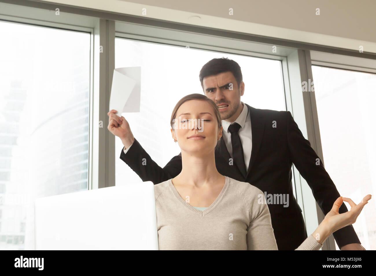 Female entrepreneur ignoring problems at work - Stock Image