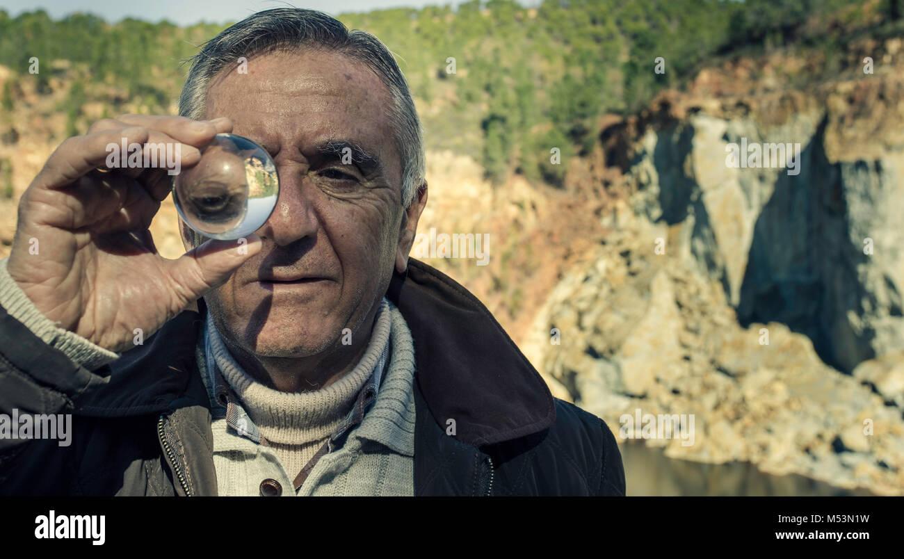Elderly man with crystal ball Stock Photo