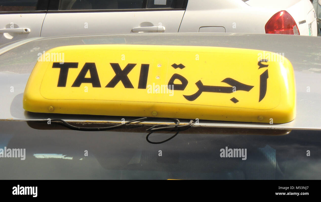 Taxi signs in English and Arabic in the Arabian Gulf Stock