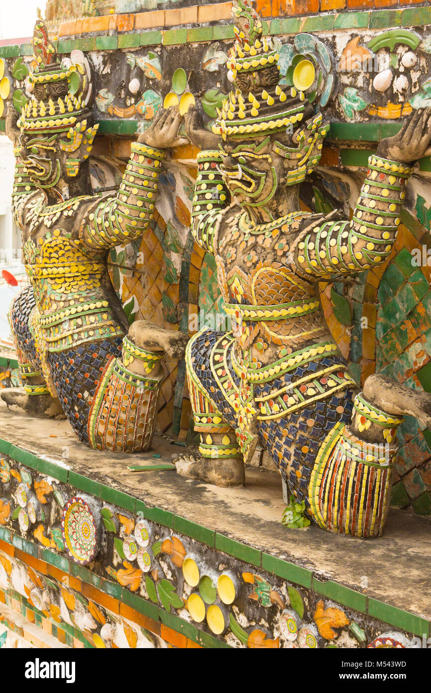 Arun Temple statues of yak supporting pagoda levels - Stock Image