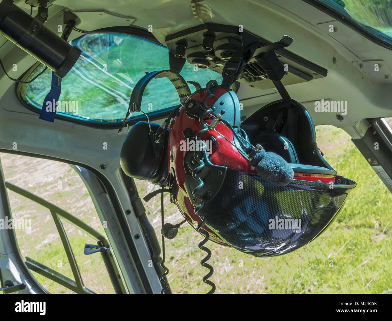 Pilot helmet in heli-cockpit - Stock Image