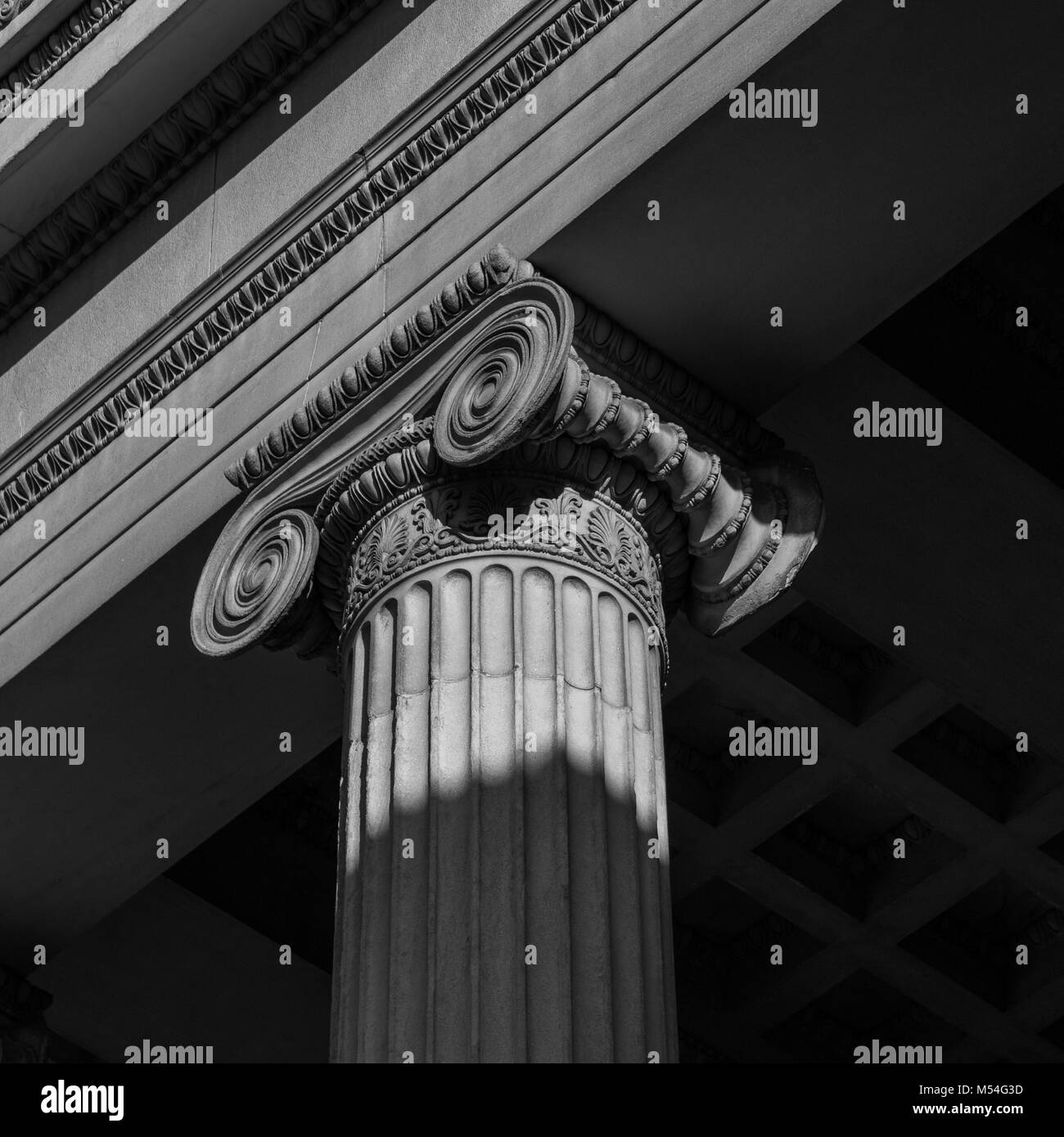 Close-up shot of a line of Greek-style columns. - Stock Image