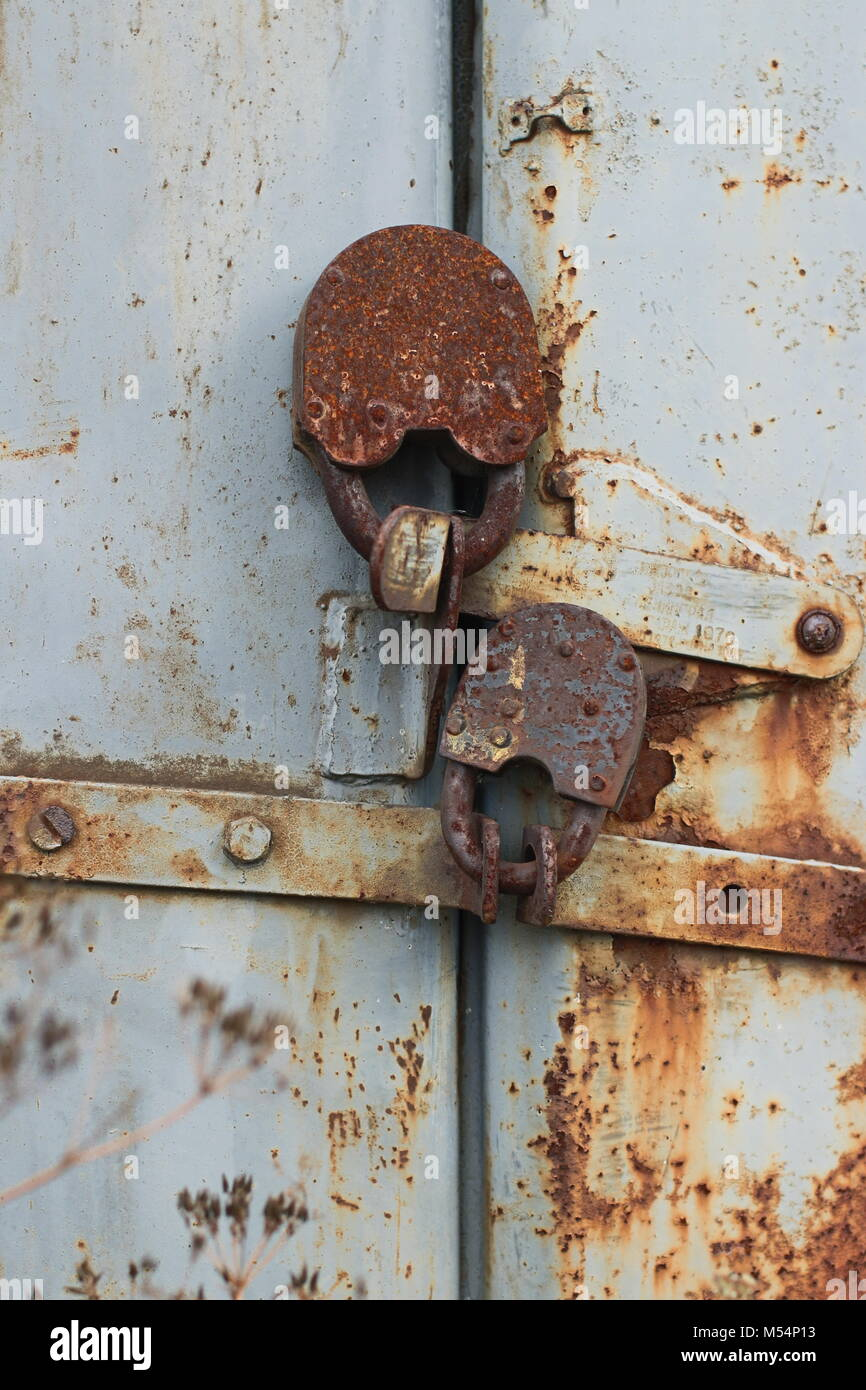 two old reliable locks at gate of the barn - Stock Image