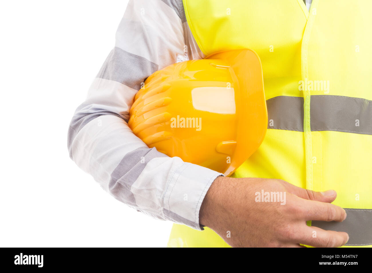 Closeup of a constructor holding yellow worker hat underarm on white copyspace and text area - Stock Image