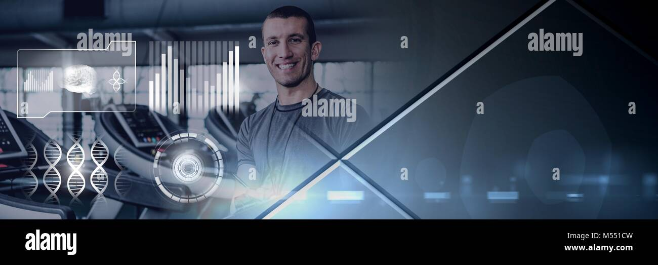 Athletic fit trainer man in gym with health interface Stock Photo