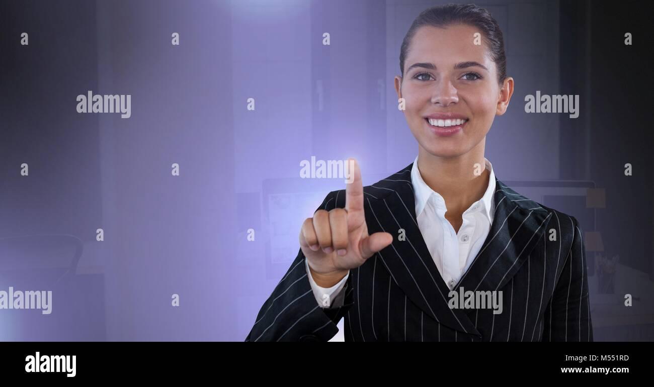 Businesswoman touching air glow Stock Photo