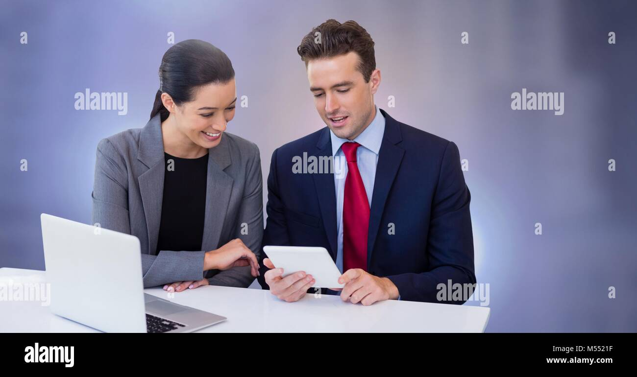 Business couple working on laptop with tablet Stock Photo