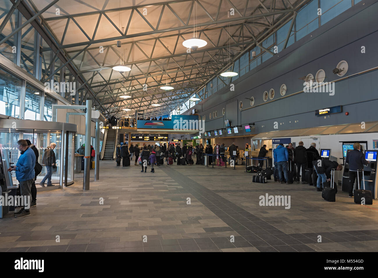 The airport hall from Tromso airport with the check in area - Stock Image
