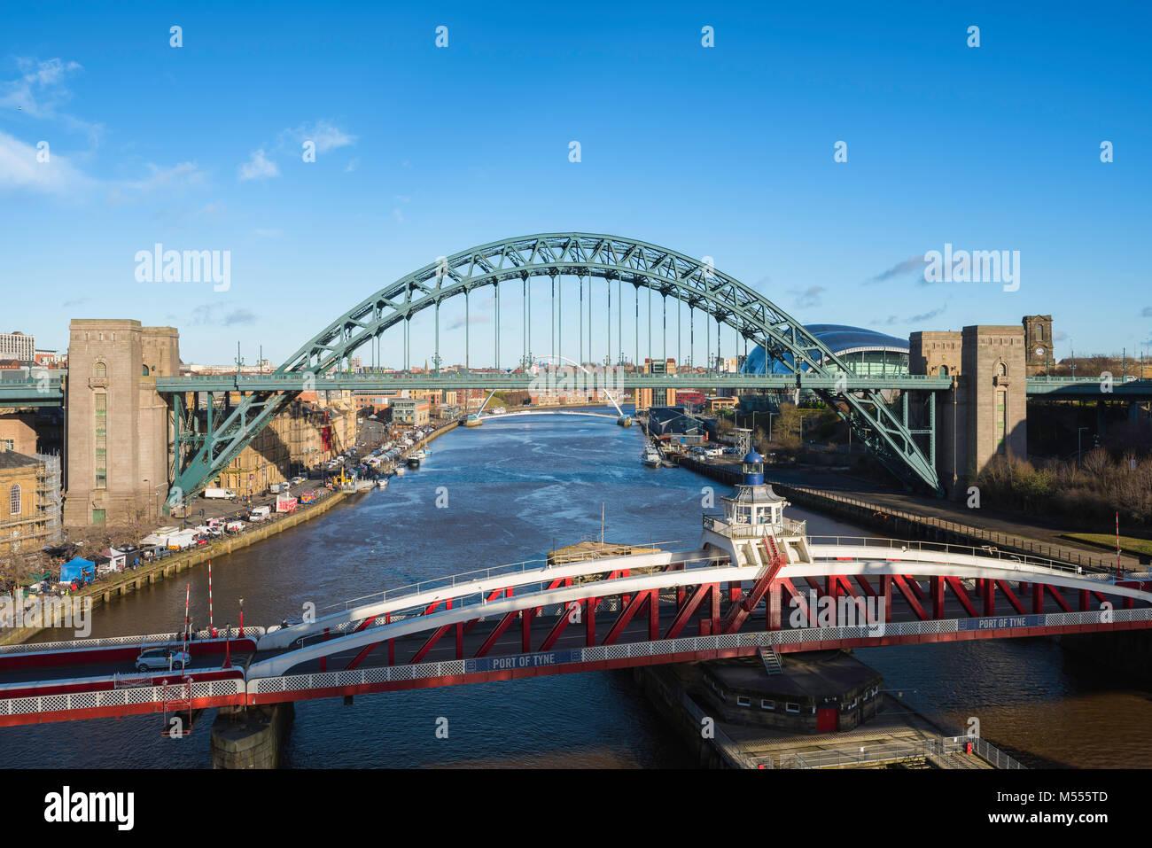 Newcastle upon Tyne, view of the the landmark Tyne Bridge and (foreground) Bridge Street swing bridge spanning the Stock Photo