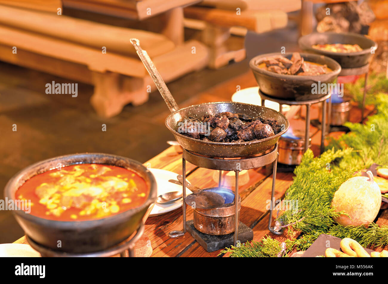 Rustic Dishes Of A Lunch Buffet In Medieval Restaurant