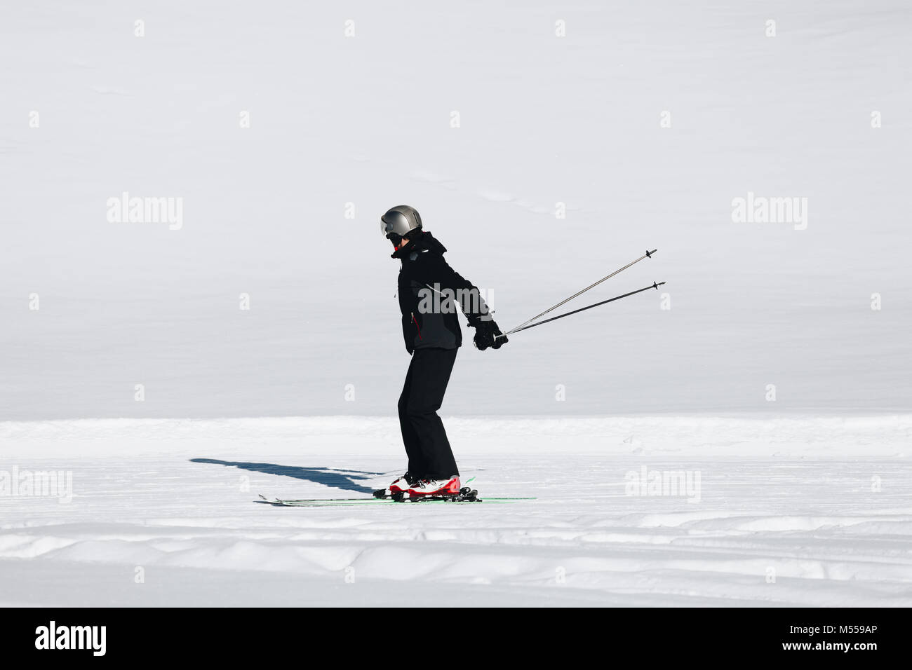 Isolated Skier skiing in mountain. - Stock Image