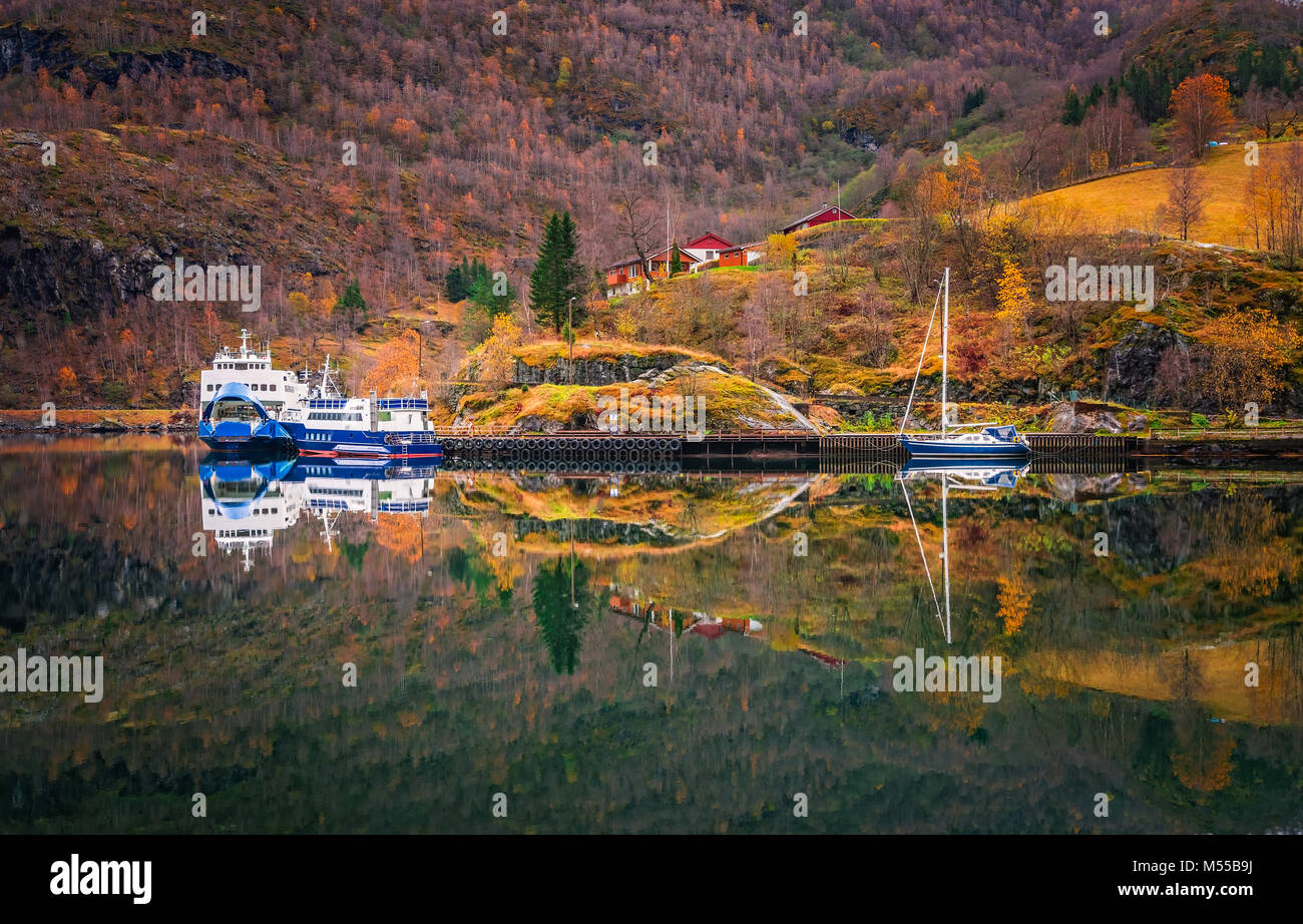Ferry and boat anchored on the fjord shore in Flam - Stock Image