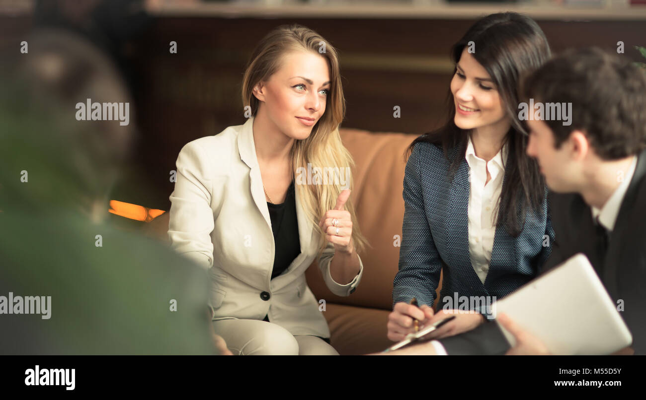 A group of successful businessmen. Discussion of the important the office - Stock Image